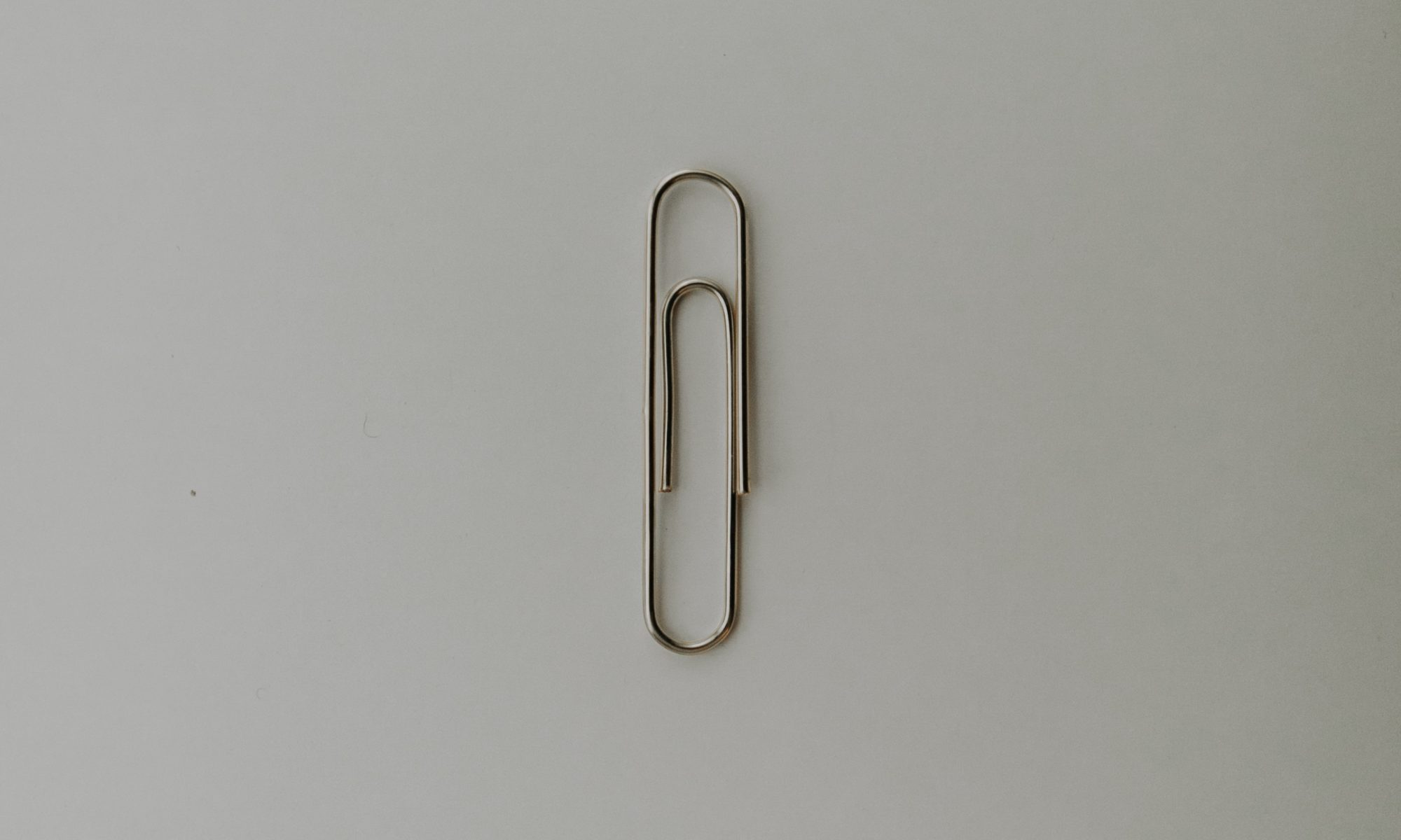 Photo of a paper clip; indicates simplicity